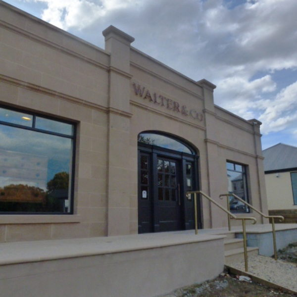 beige stone exterior walter & co